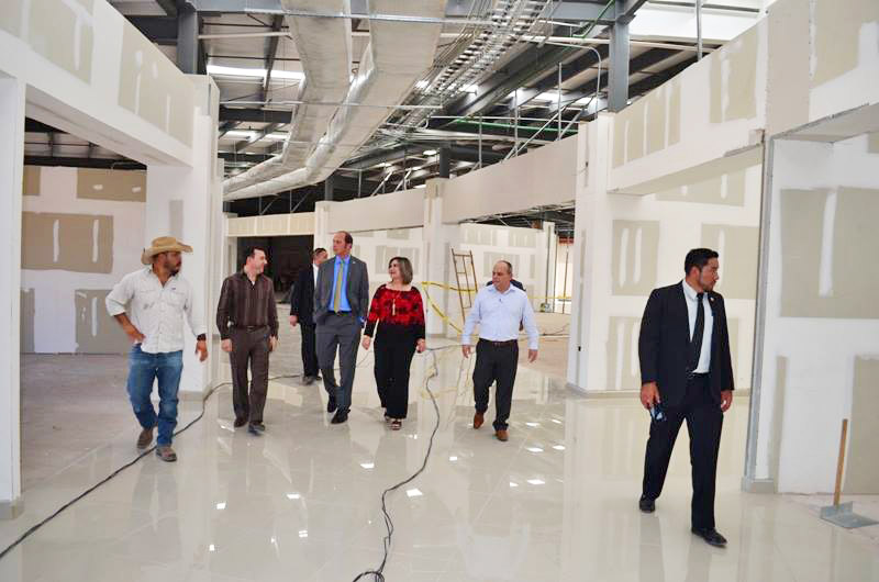 Christopher Teal and city dignitaries tour Omega Plaza